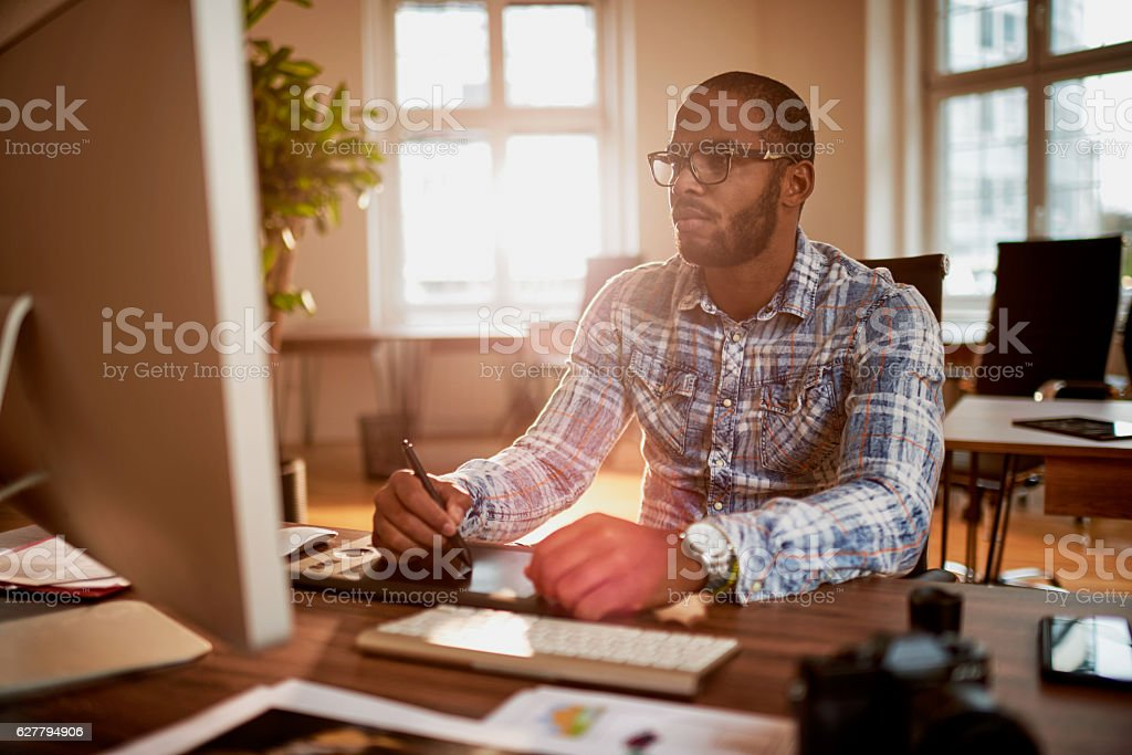 Photographer Working In his Office stock photo