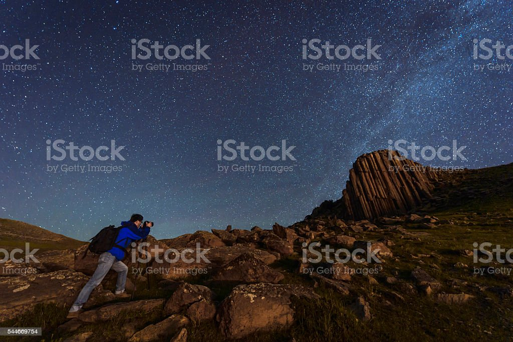 Photographer working under the night sky stock photo