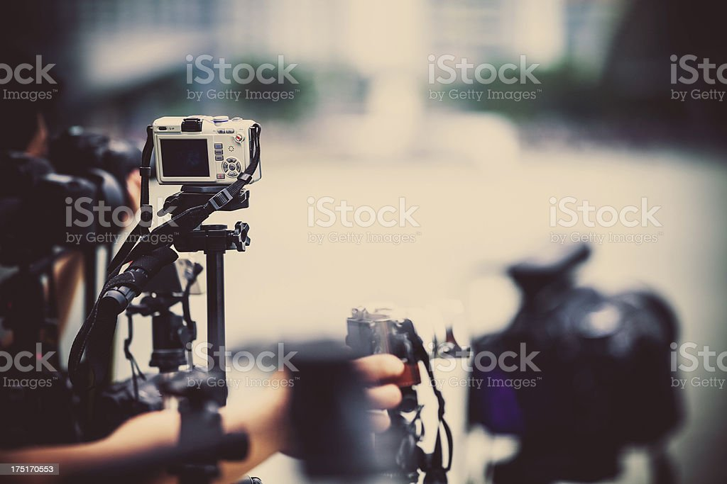 Photographers and Digital Cameras on Tripods stock photo