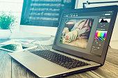 Photographers computer with photo edit programs.