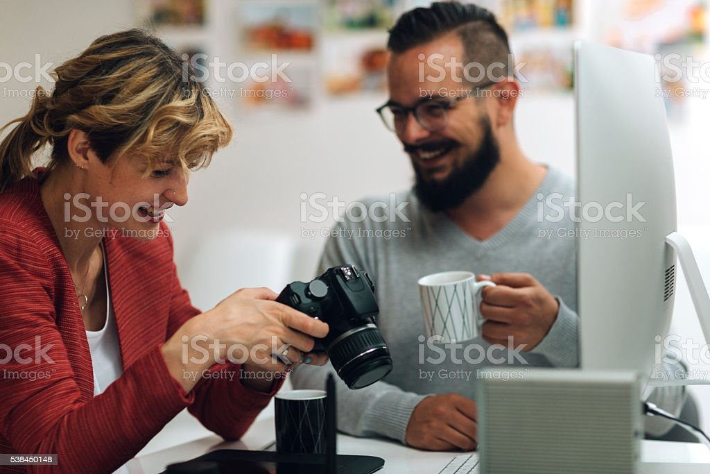 Photographers Looking Images on thier Digital Camera. stock photo