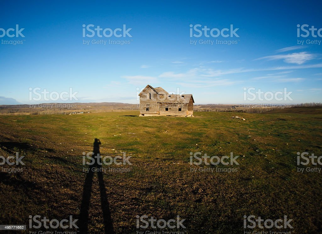 photographer's shadow in shot of old farmhouse stock photo