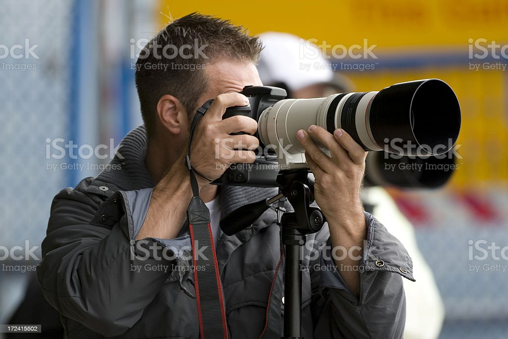 Photographers with Telephoto Lens stock photo