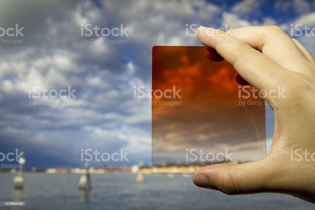 Photographic  equipment  in the hand (filter) on Venice background royalty-free stock photo
