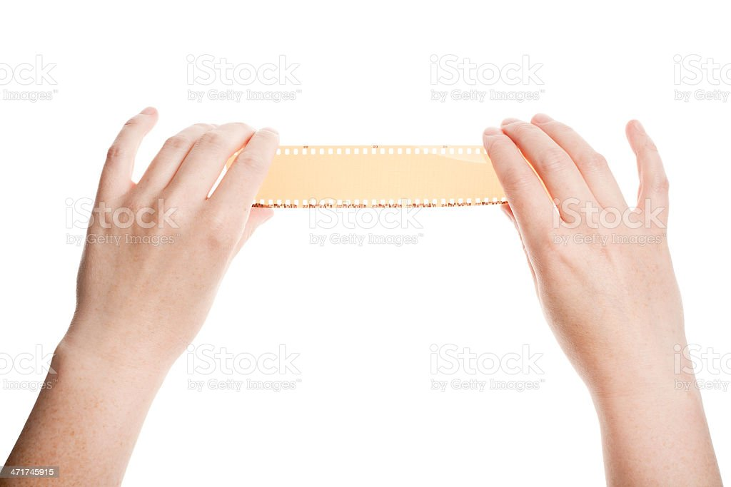 Photographic film in hands stock photo