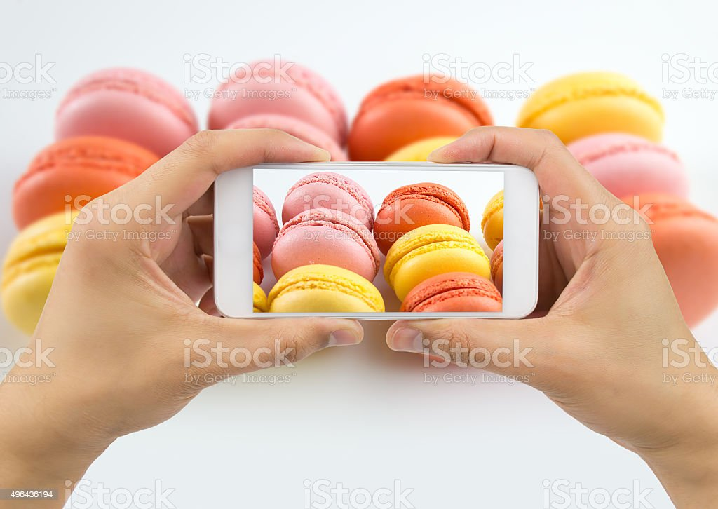 photographing a plate of macarons stock photo