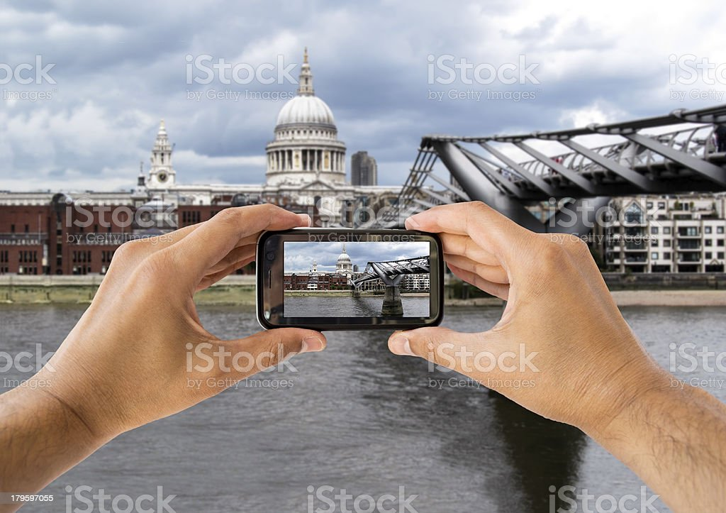 photographing at ST Paul Cathedral and  Millennium Bridge royalty-free stock photo