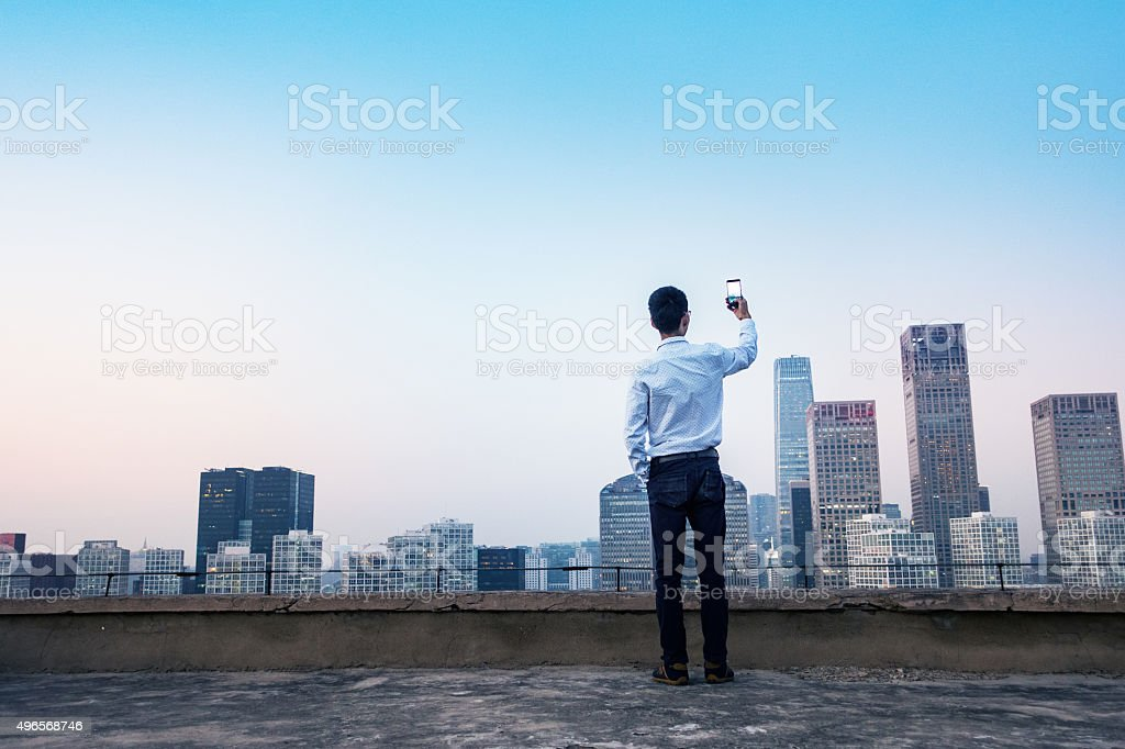 Photographing city skyline stock photo