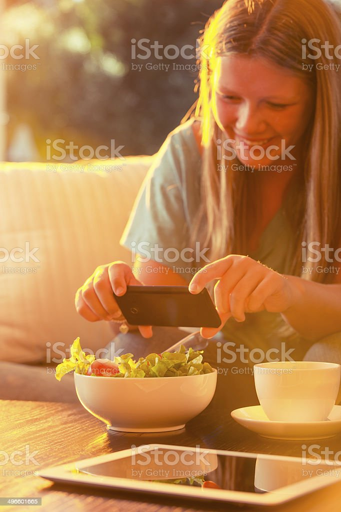 Photographing food with a mobile phone royalty-free stock photo