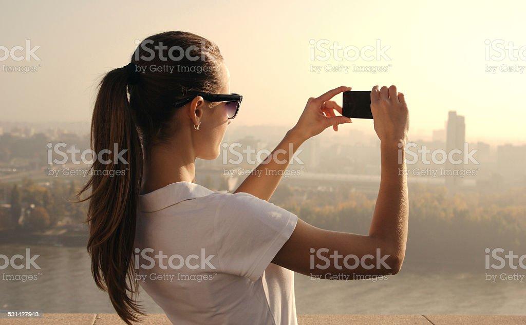 photographing girl stock photo