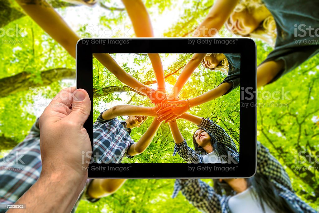 Photographing Group of friends with hands in hands - Teamwork stock photo