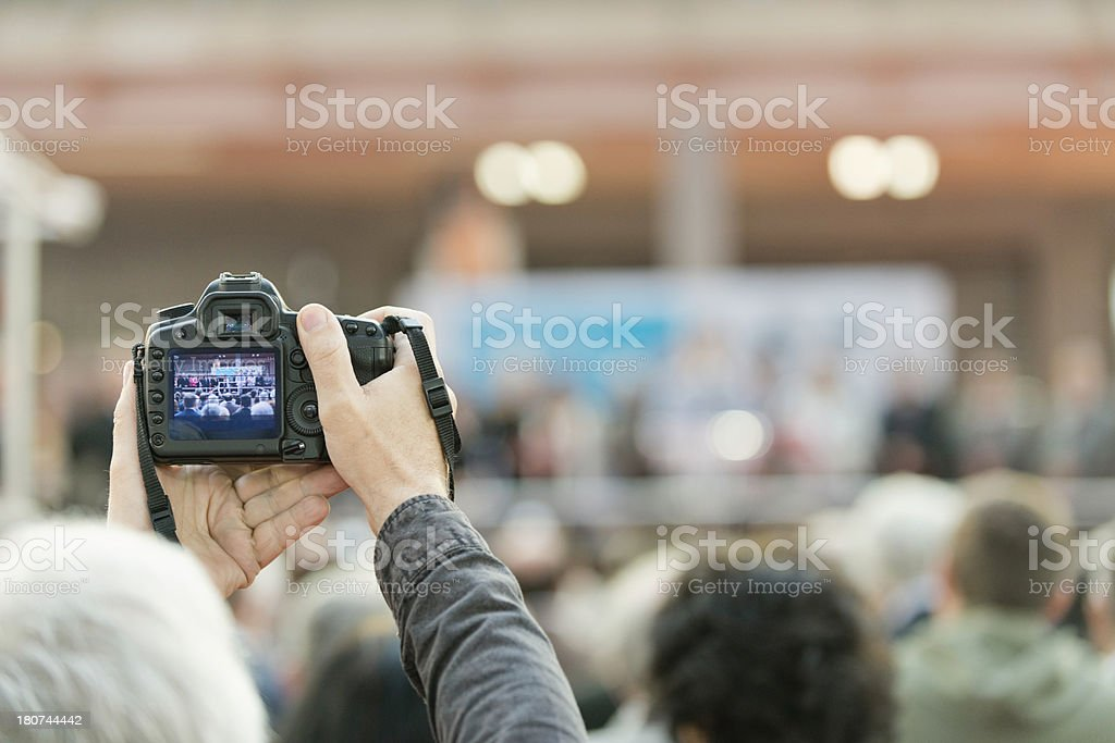 Photographing large public event royalty-free stock photo