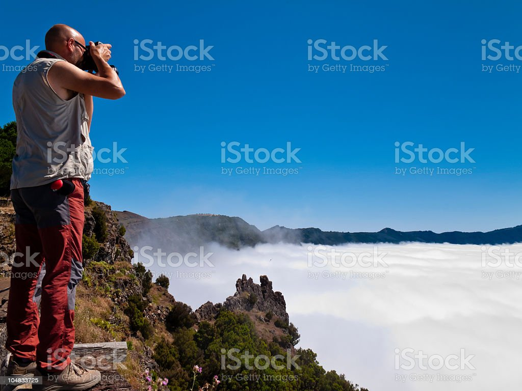 Photographing Over The Clouds stock photo