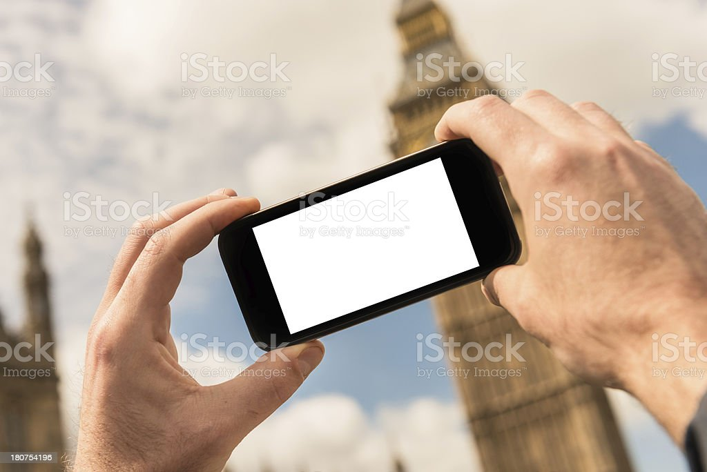 photographing the Big Ben tower with smartphone royalty-free stock photo