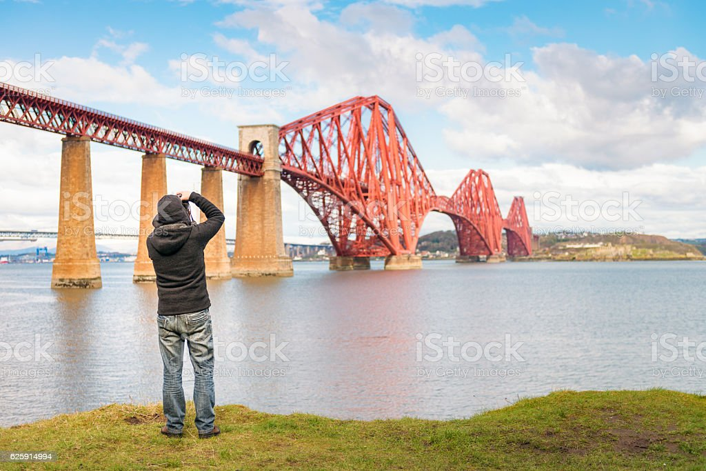 Photographing the Forth Bridge in Scotland stock photo