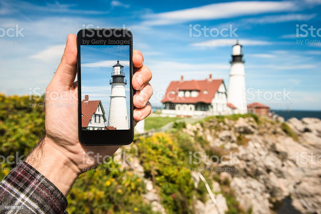 photographing the lighthouse on Portland - maine stock photo