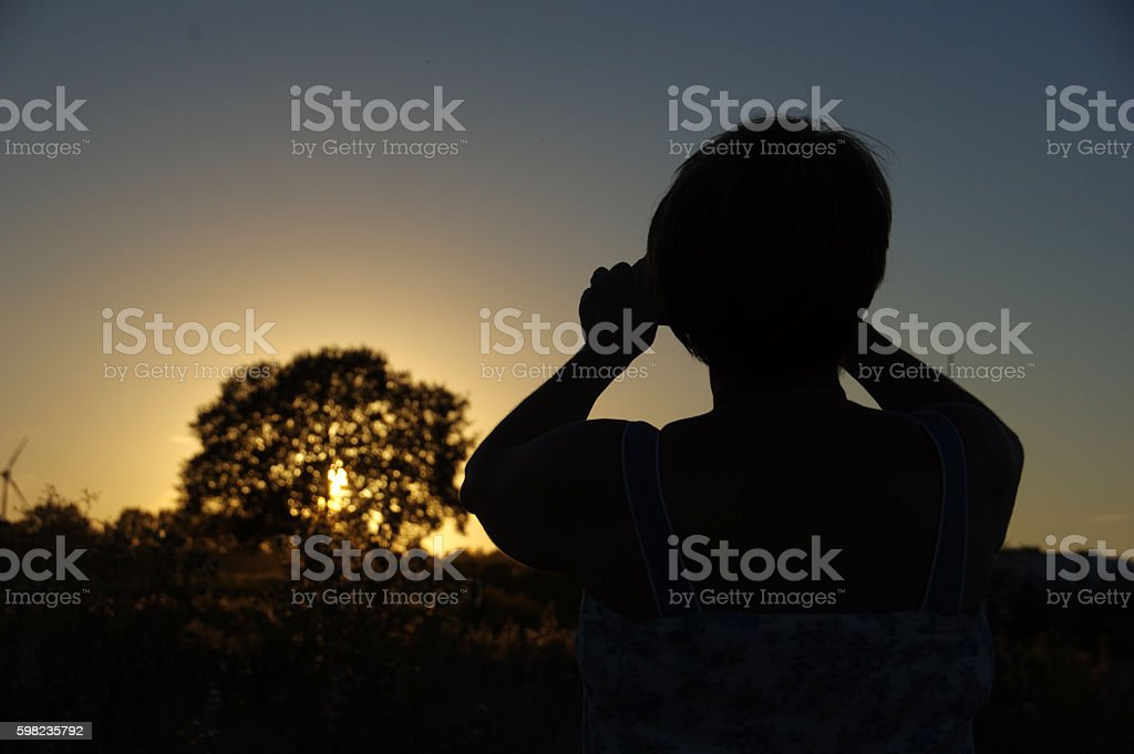 Photographing the sunset stock photo