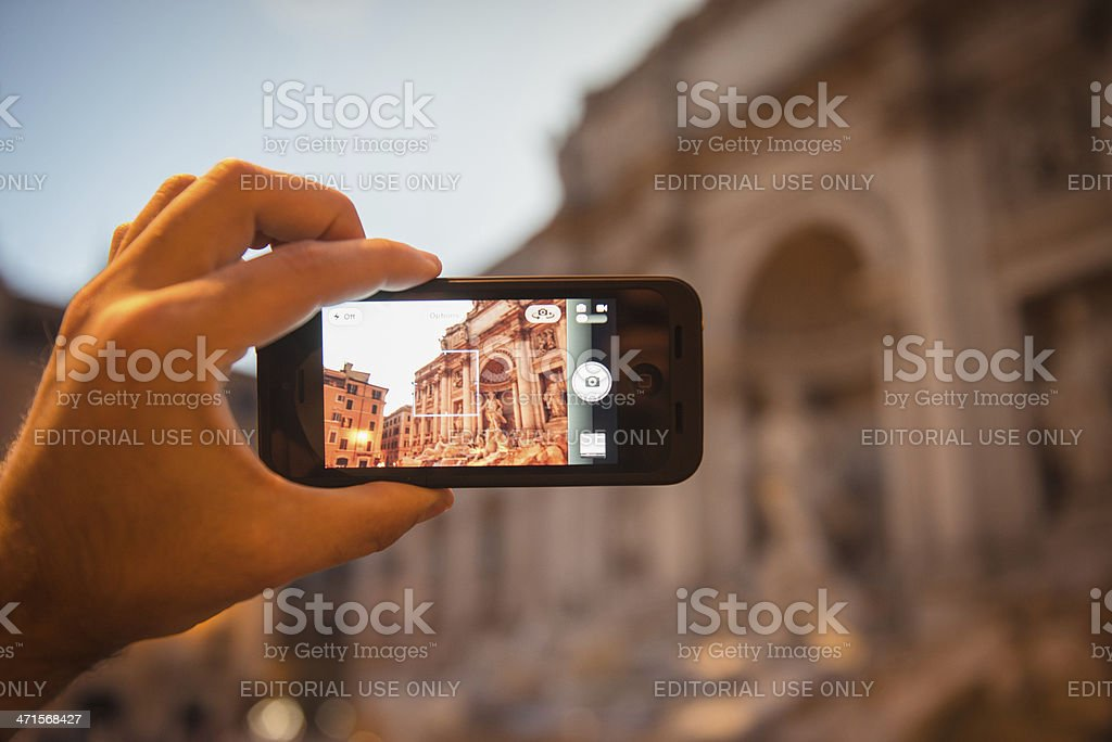 photographing the Trevi Fountain in rome stock photo