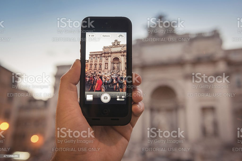 photographing the Trevi Fountain in rome royalty-free stock photo