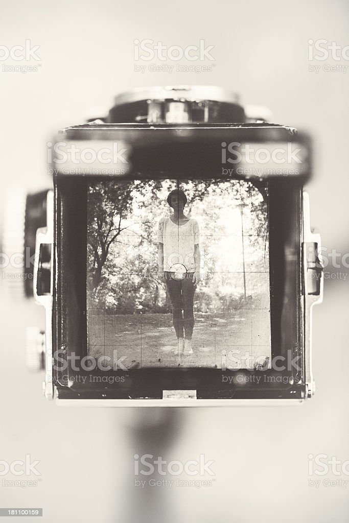 Photographing with a vintage camera royalty-free stock photo