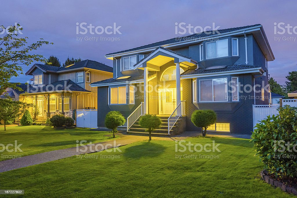 Photography of a big house at dusk with illumination inside stock photo