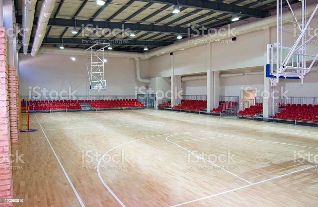 Photography of a large and empty basketball stadium stock photo