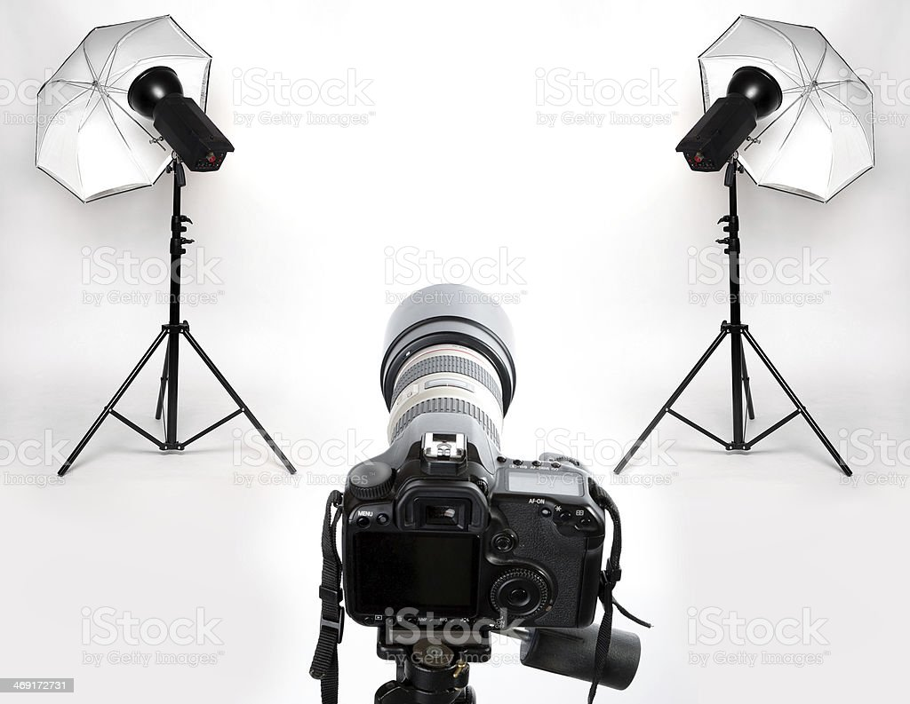 Photography studio with white backdrop ready for shoot stock photo