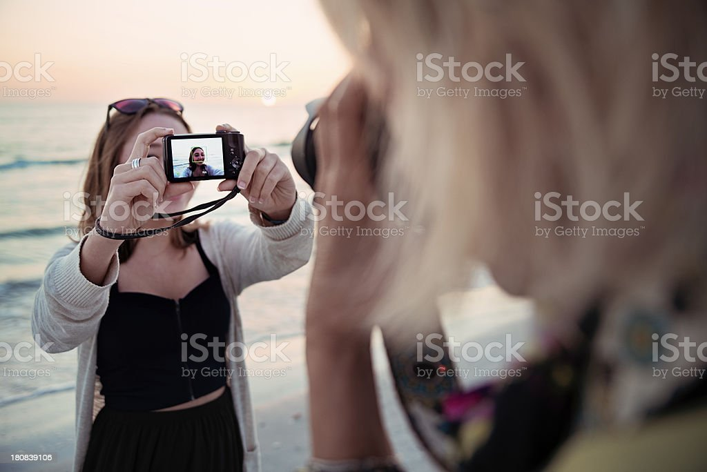 Photographying the photographer on beach at sunset. royalty-free stock photo