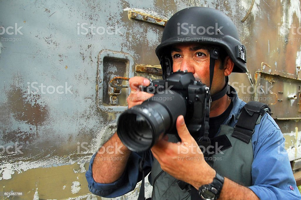 Photojournalist documenting war and conflict stock photo