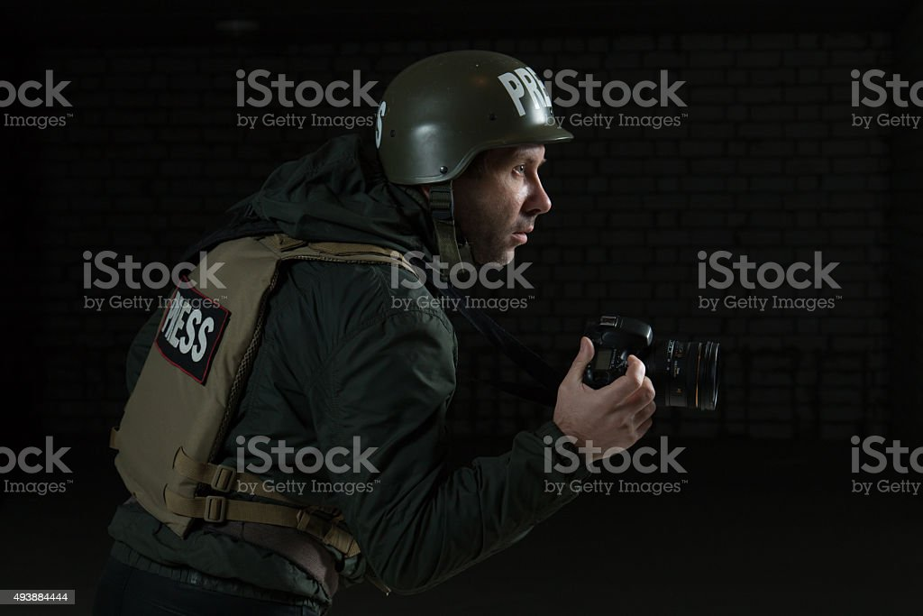 Photojournalist in a helmet and flak jacket stock photo