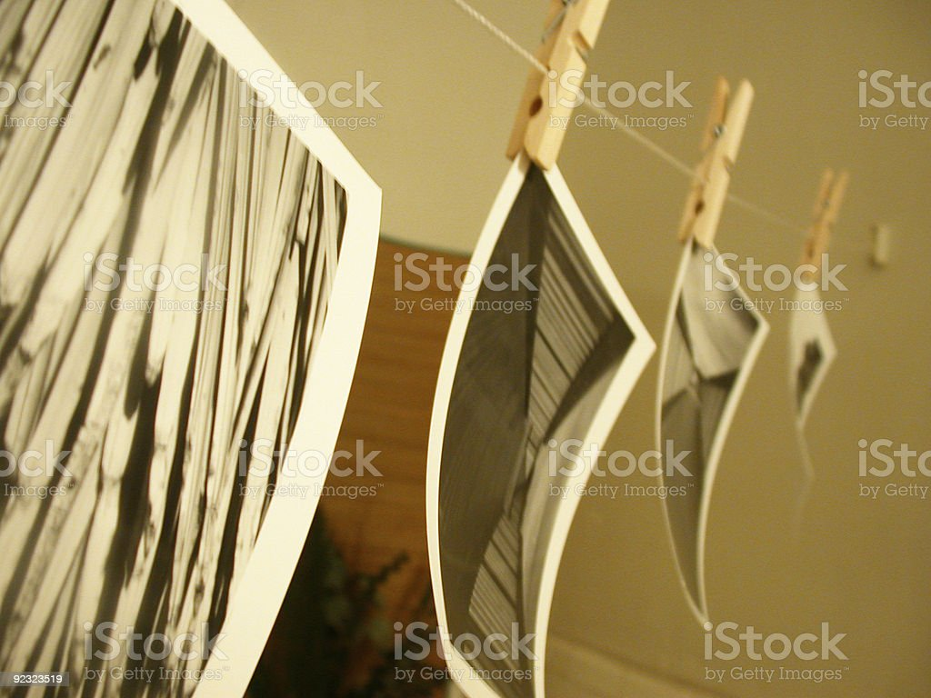 photos hanging to dry stock photo