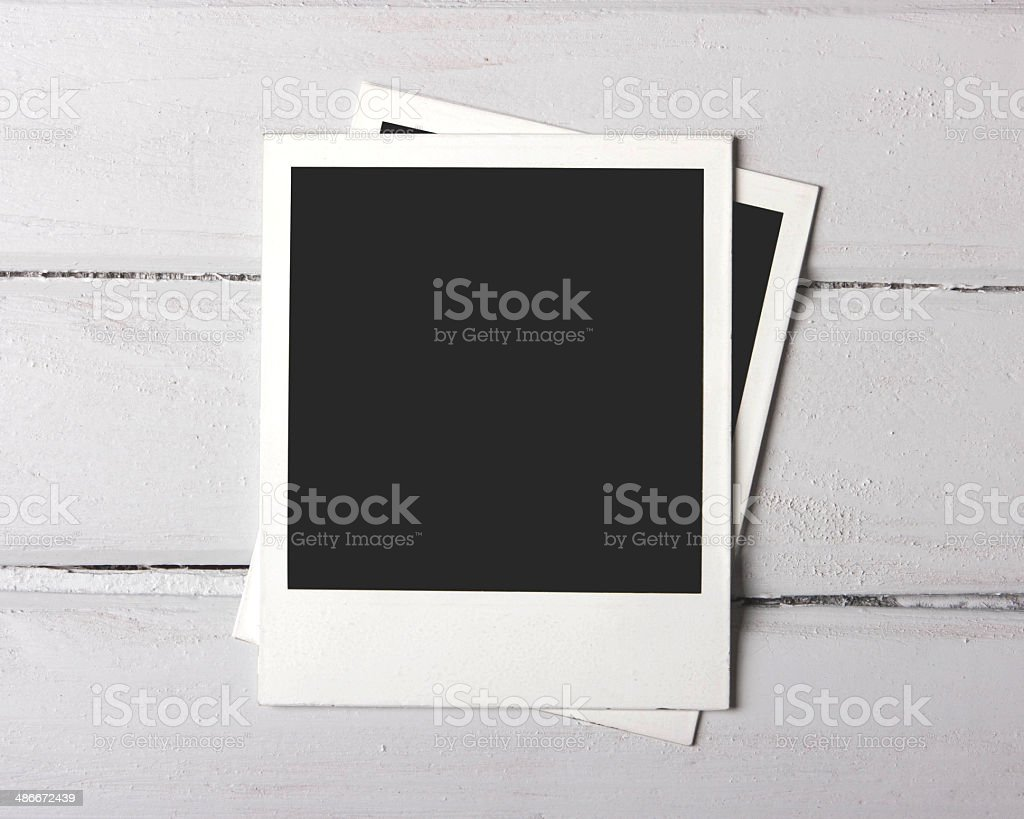 Photos on white plank stock photo