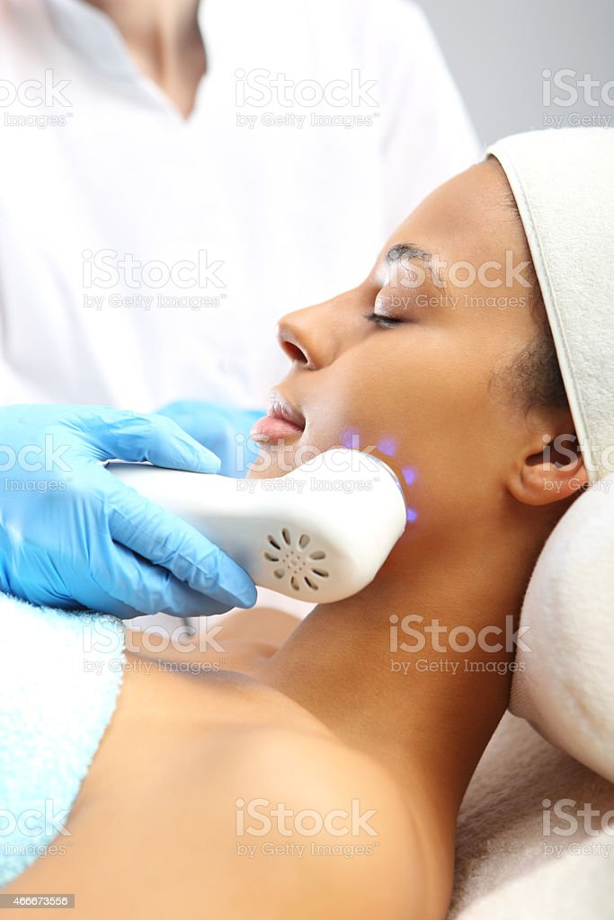 Phototherapy, a woman in the beauty salon stock photo