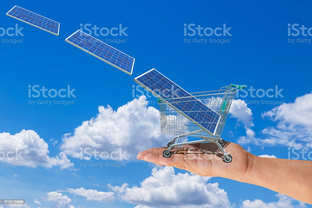 Photovoltaic in trolley cart on hand stock photo