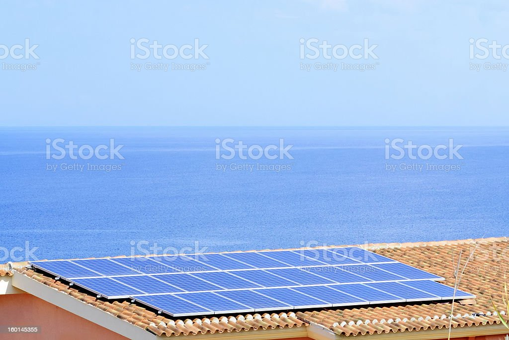 photovoltaic panels on a roof royalty-free stock photo