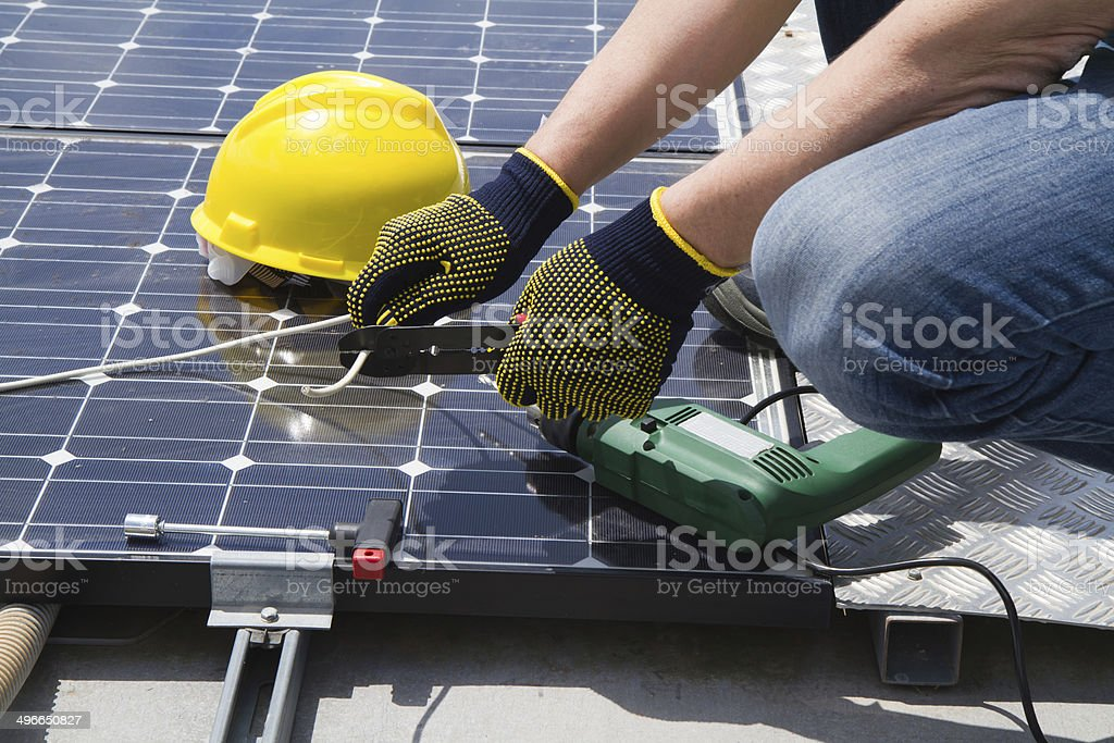 photovoltaic skilled worker stock photo