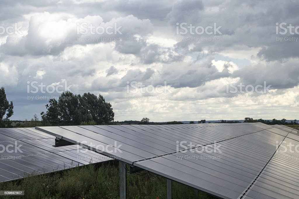 Photovoltaic Solar plant in a landscape. stock photo