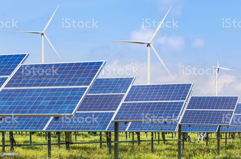 Photovoltaics module solar panels and wind turbines generating electricity stock photo