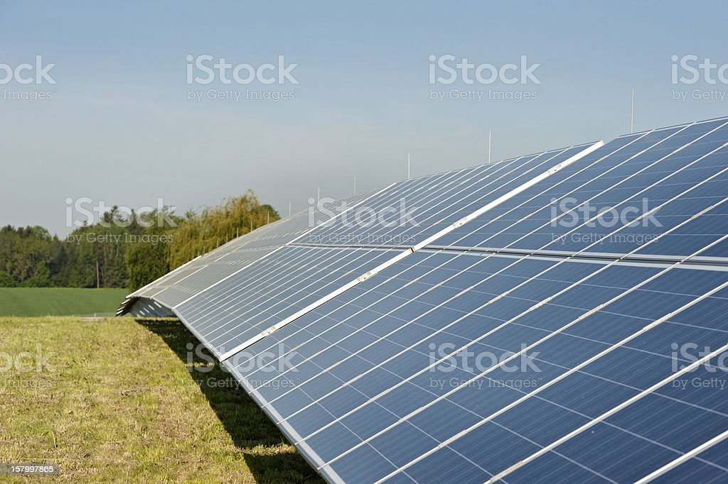 Photovoltaik - renewable and green engery: row of solar panels stock photo