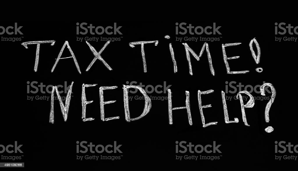 Phrase 'TAX TIME. NEED HELP?' written with chalk stock photo