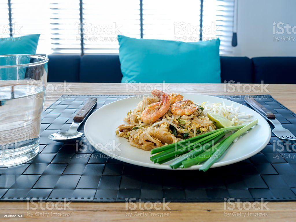 Phud thai (Thai noodle) on modern dining table stock photo
