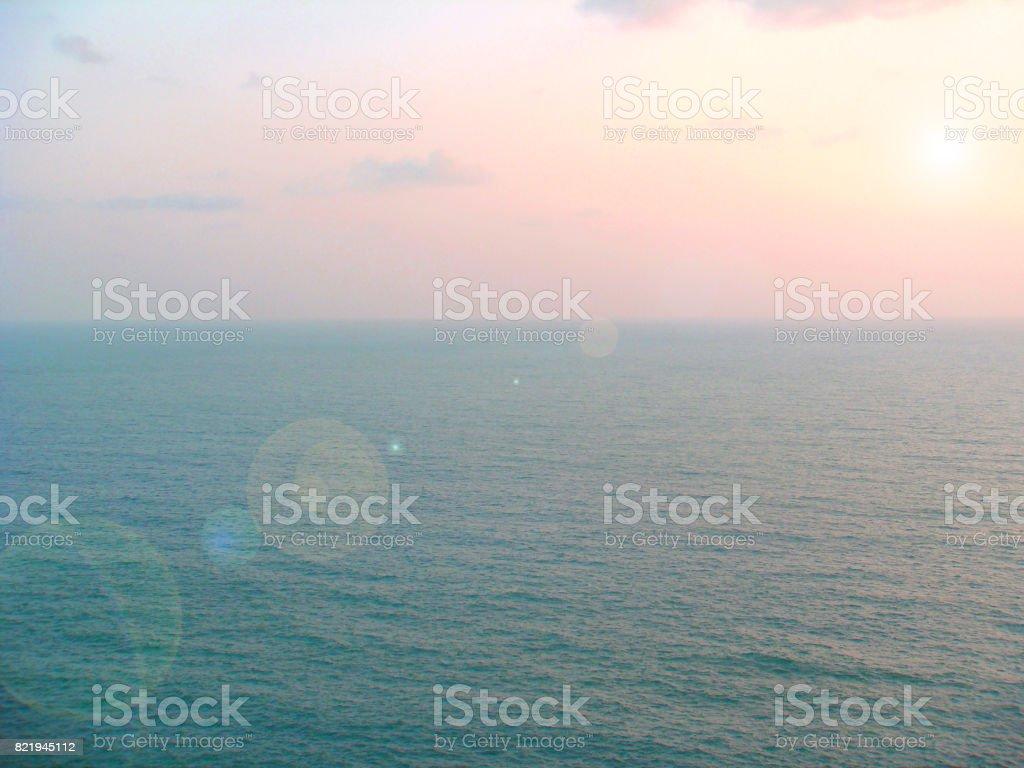 Phuket beach near the evening sun goes down beautiful light. stock photo