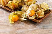 Physalis in wooden dish