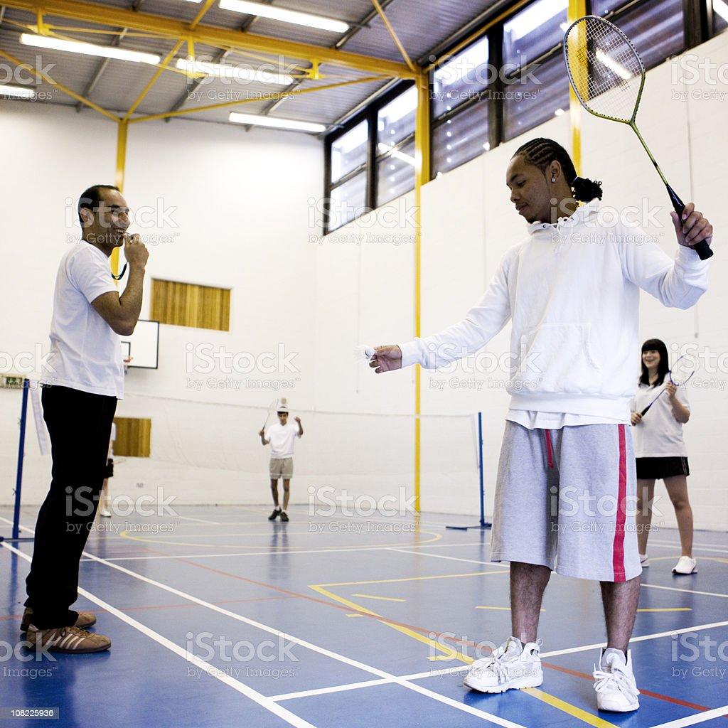 physical education: badminton class stock photo