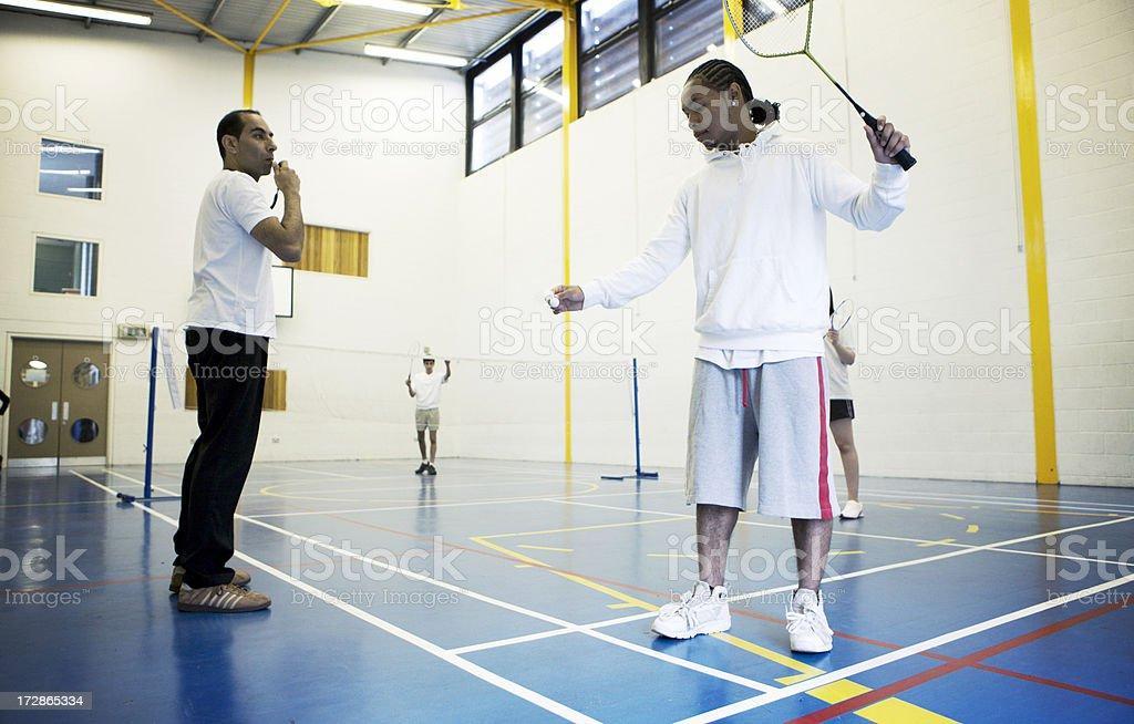 physical education: badminton lesson stock photo