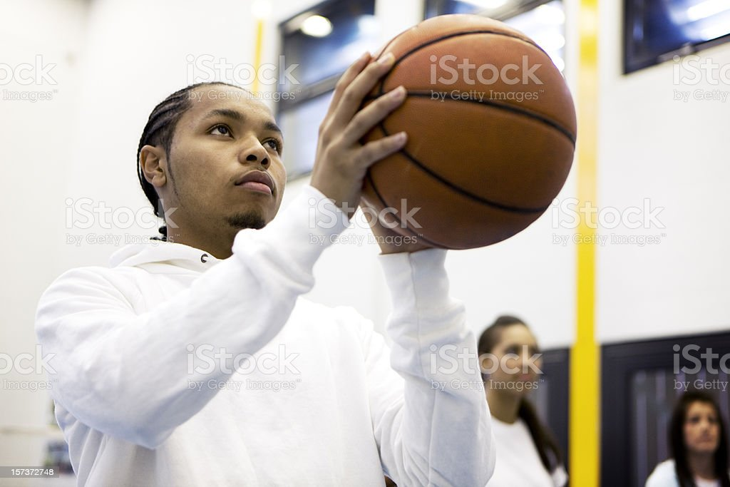 physical education: basketball player focusing on taking a penalty stock photo