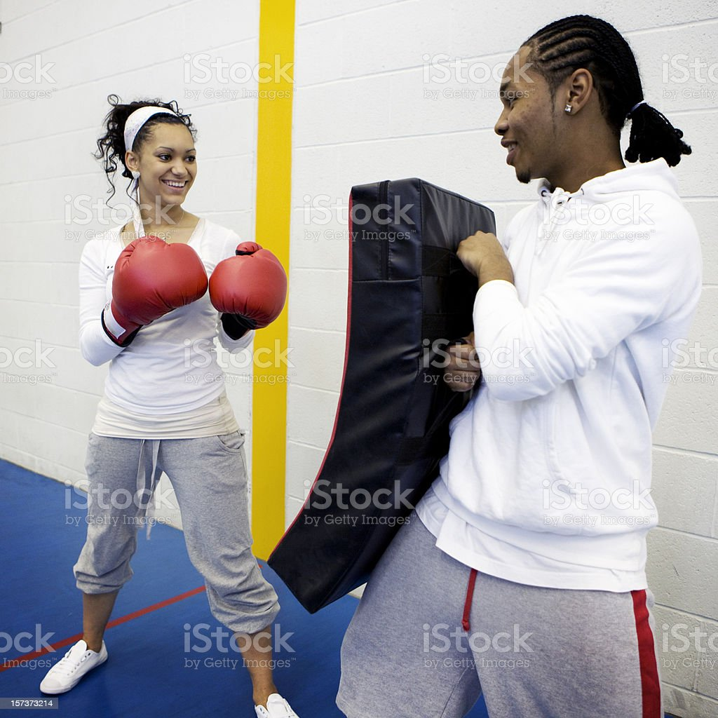 physical education: sports pupils sparring in the school gym stock photo