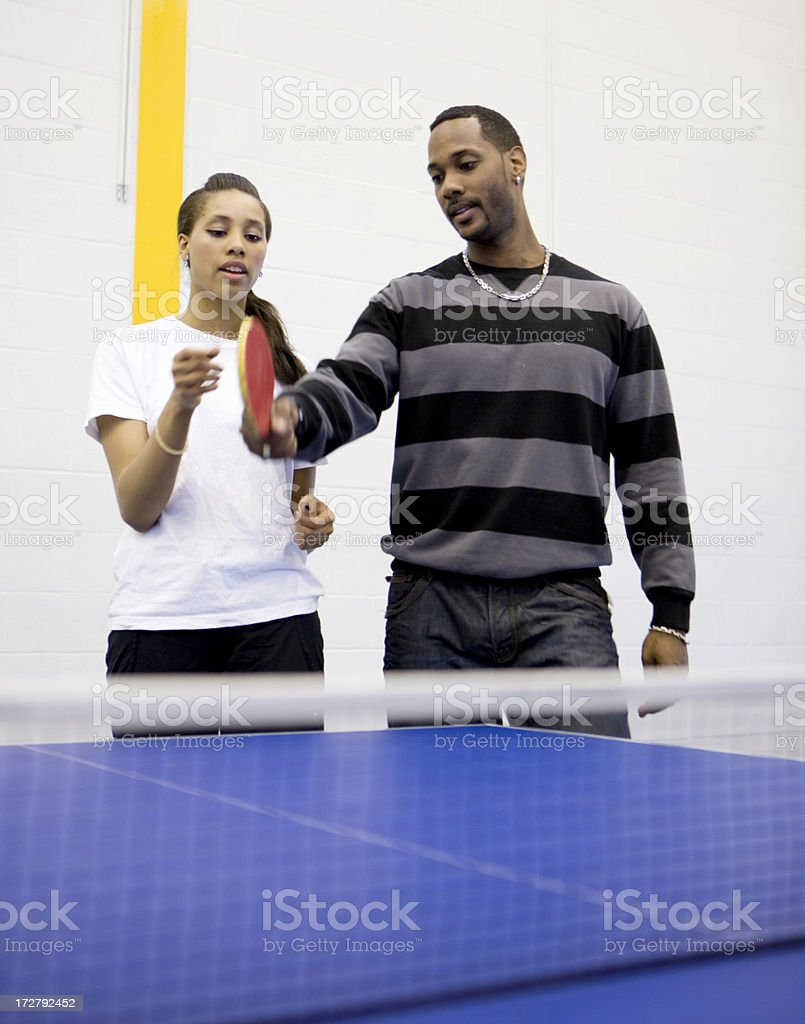 physical education: table tennis tuition stock photo