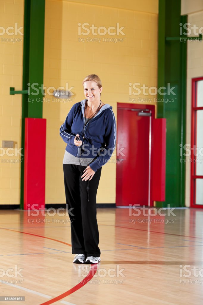 Physical education teacher in school gymnasium stock photo