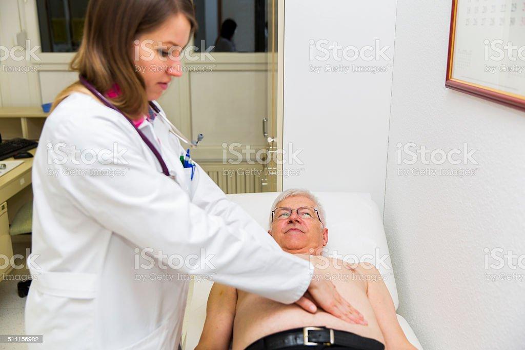 Physical Examination Of Abdomen stock photo